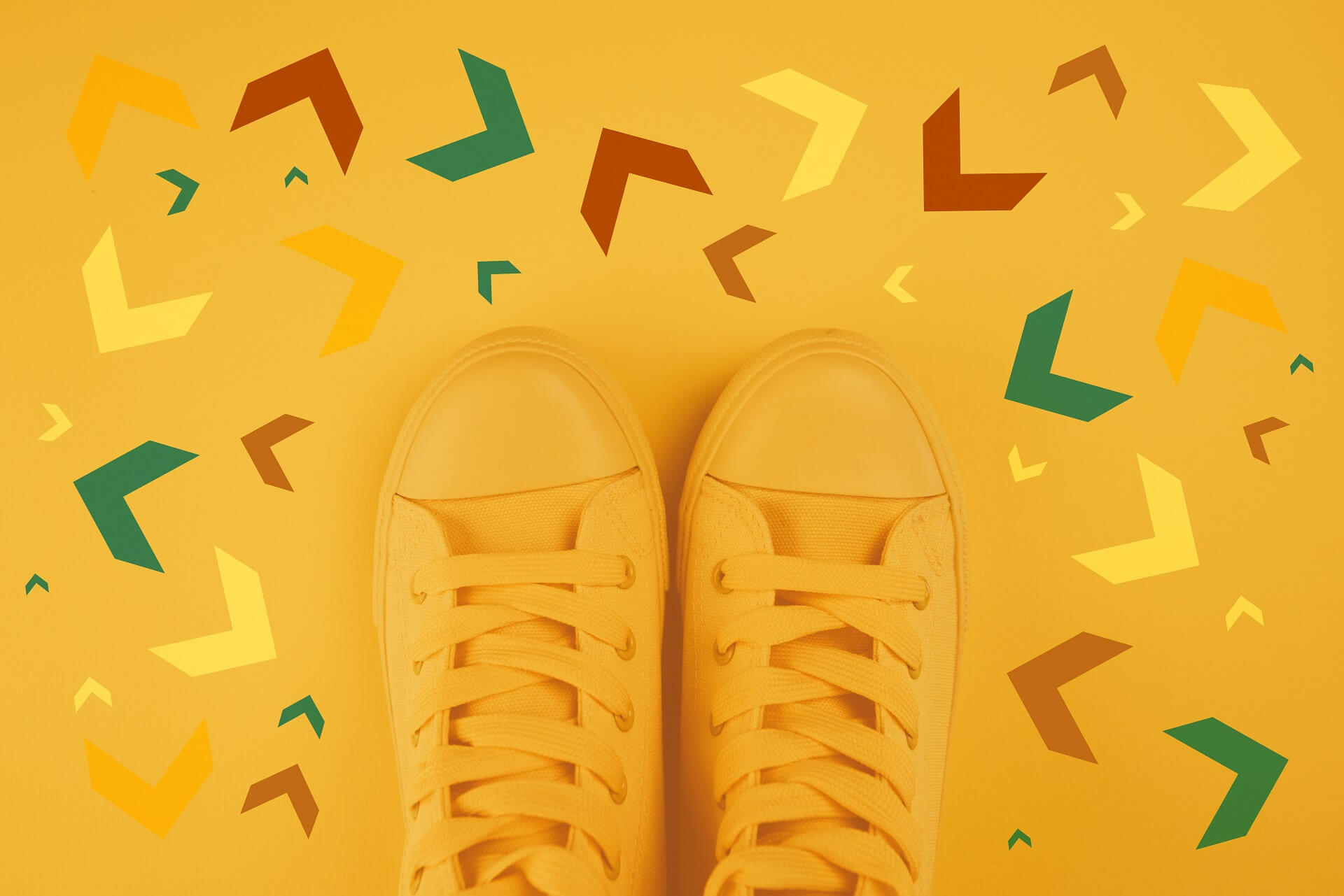 making decisions concept with yellow sneakers surrounded by arrows